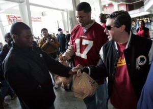 Dan Snyder and Jason Campbell passing out turkeys Thanksgiving 2007